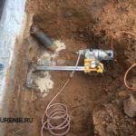 Бурение отверстий в фундаменте под тубы